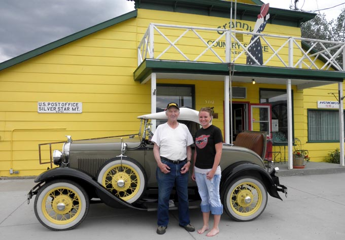 Cassie and Lloyd in front of store